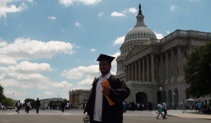Graduate in front of the capital building, Photo by America's Voice.